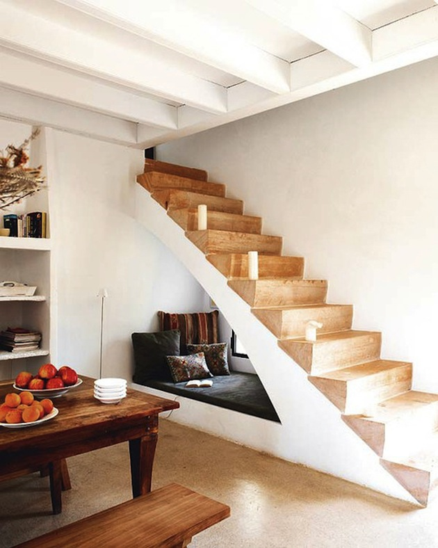 sofa under staircase
